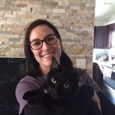 Sarah Tremblay holding a black cat
